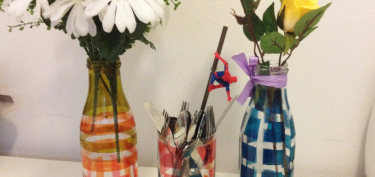 Flower vase with used juice bottles